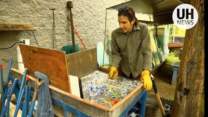 Student sorts through recycled glass