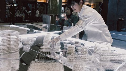 Yusuke Aonuma installing his artwork